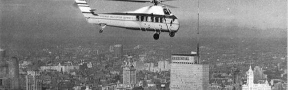 A Chicago Helicopter Airways Sikorsky S-58C passing over a mid-20th century Chicago skyline.