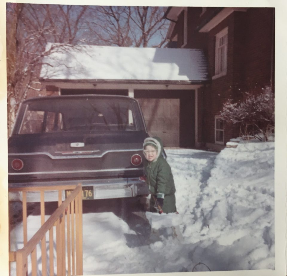 Mary shoveling snow at 615 Cherry Street, winter of 1967