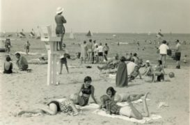 Swimmers, sailors, and sunbathers at Lloyd Beach, 1975.  Photo from WHS Archives.